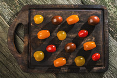 Variety of cherry tomatoes on wood Royalty Free Stock Images
