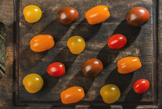 Variety of cherry tomatoes on wood Royalty Free Stock Photos