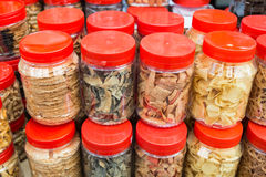 Variety Chinese New Year cookies in jars. Variety Chinese New Year cookies in plastic jars