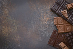 Variety of chocolate bars with spices.Top view. Variety of chocolate bars with spices on an old rusty metal background.Top view Royalty Free Stock Image