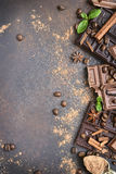 Variety of chocolate bars with spices.Top view. Variety of chocolate bars with spices on an old rusty metal background.Top view Stock Photography