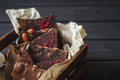 Variety of chocolate bars in wooden box Stock Photos