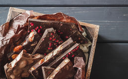 Variety of chocolate bars in wooden box Stock Photography