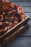 Variety of chocolate bars in wooden box Royalty Free Stock Photo