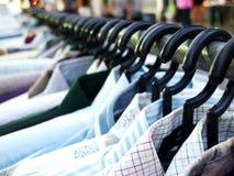Variety. Choice variety men shirts hang on the rack. Selective focus Royalty Free Stock Photos
