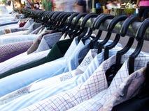 Variety. Choice variety shirts hang on the rack. Close up Stock Photos