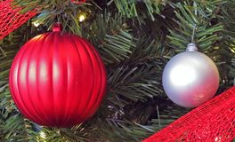 A Variety of Christmas Ornaments. On a Christmas Tree symbolizing Peace on Earth to all, even if they are different in some way Stock Image