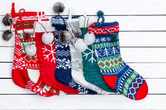 Variety of Christmas Stockings on White Wood table Royalty Free Stock Photography