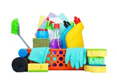 Variety of cleaning supplies in a basket Stock Photo