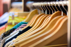 Variety of clothes hanging on rack Stock Photo