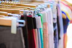 Variety of clothes hanging on rack Stock Photography