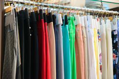 Variety of clothes hanging on rack Royalty Free Stock Photo