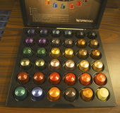 Variety of coffee capsules in Nespresso store Stock Photo