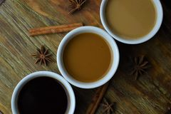 Variety of coffee on wood background. Royalty Free Stock Photos