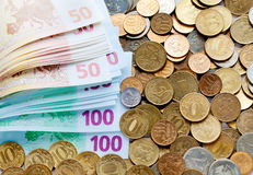 Variety of coins and euro banknotes Royalty Free Stock Photos