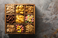 Variety of cold cereals in a wooden box overhead Royalty Free Stock Photo