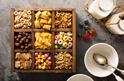 Variety of cold cereals in a wooden box overhead Royalty Free Stock Photos