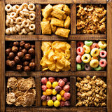 Variety of cold cereals in a wooden box overhead Stock Photos