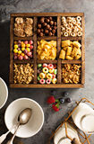 Variety of cold cereals in a wooden box overhead Royalty Free Stock Photography
