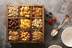 Variety of cold cereals in a wooden box overhead Stock Image