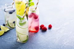 Variety of cold drinks in bottles Stock Photos