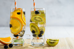 Variety of cold lemonade with fruit and berries. Variety of cold lemonade in a glass with fruit and berries Royalty Free Stock Images
