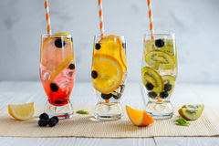 Variety of cold lemonade with fruit and berries. Variety of cold lemonade in a glass with fruit and berries Stock Images