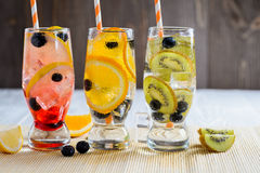 Variety of cold lemonade with fruit and berries. Variety of cold lemonade in a glass with fruit and berries Royalty Free Stock Photography
