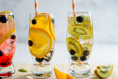 Variety of cold lemonade with fruit and berries. Variety of cold lemonade in a glass with fruit and berries Stock Photography