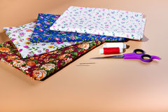 A variety of colored fabrics. Cotton, calico, chintz. Needlework. Different colored fabrics: cotton, calico, chintz. Sewing kit. Tools for needlework Stock Photo