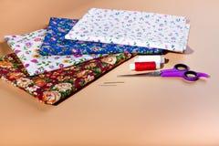 A variety of colored fabrics. Cotton, calico, chintz. Needlework Stock Photo