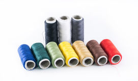 Variety of colored threads placed next to each other Stock Image
