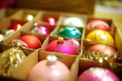 Variety of colorful Christmas baubles in a boxes. Trimming the Christmas tree. Royalty Free Stock Image