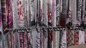 A variety of colorful fabric samples on display. Automated industrial sewing weaving knitting embroidery loom machine in textile cotton industry production stock video footage