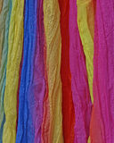 Variety of colorful fabrics background Stock Photos