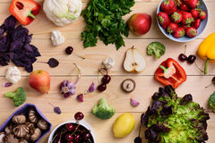 Variety of colorful fruits, vegetables and berries. Healthy diet concept. Vegetarian organic food set over wooden table. Top view. Royalty Free Stock Photos