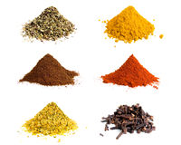 Variety of colorful grounds spices. Studio isolated Royalty Free Stock Images