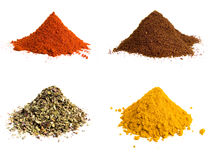 Variety of colorful grounds spices. Studio isolated Royalty Free Stock Photos