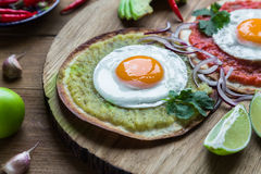 Variety of colorful mexican cuisine breakfast dishes on a wooden table Royalty Free Stock Image