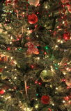 Variety of colorful ornaments on Christmas tree Royalty Free Stock Images