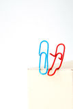 Variety of colorful paper clips,  family talk together concept Stock Photos
