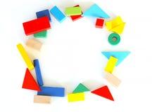 Colorful toy blocks flat lay circle on white background. Variety of colorful toy blocks in circle shape flat lay with white background Stock Image