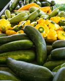 A variety of colorful vegetables for sale at an outdoor market. stock photography