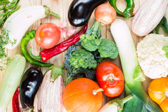 A variety of colorful vegetables at wooden table Stock Image