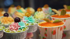 Variety of colourful cupcakes stock video footage