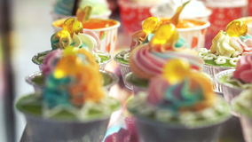 Variety of colourful cupcakes stock video