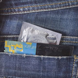 Variety of Condoms in the blue jeans pocket. Three condoms in blue jeans pocket Royalty Free Stock Photo
