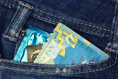Variety of Condoms in the blue jeans pocket. Three condoms in blue jeans pocket Royalty Free Stock Images