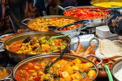 Variety of cooked curries on display at Camden Market in London. UK royalty free stock photos