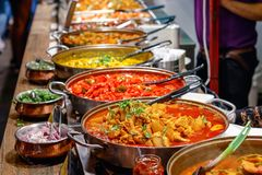 Variety of cooked curries on display at Camden Market Stock Photography